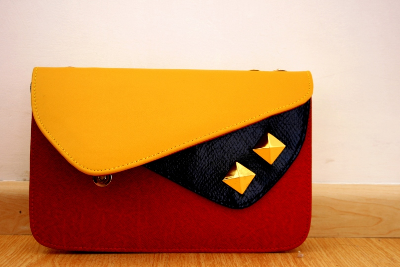colour blocking, red-yellow-black clutch, Prada look-alike clutch